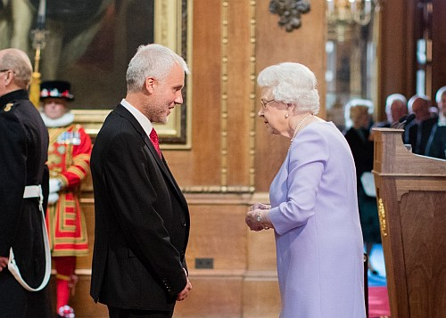 The Queen presenting the MBE to Richard